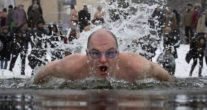 A Russian man swims in the icy water in St Petersburg, marking the 71st anniversary of breaking the Nazi siege of Leningrad.