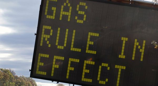 A sign is seen on the Garden State Parkway near Woodbridge, New Jersey, after a gas rationing system ordered by Gov. Chris Christie went into effect.
