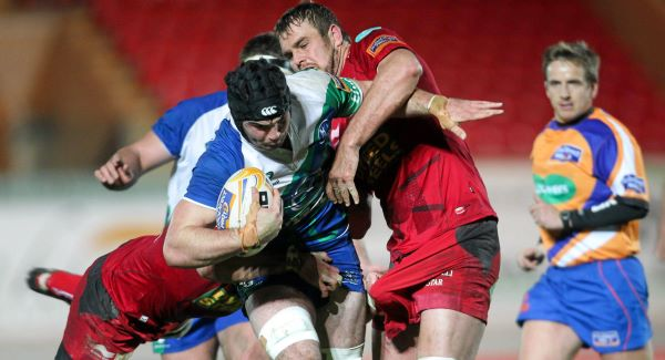 Mike Kearney, Connacht, is tackled by Johan Snyman and George Earle, Scarlets. Picture: SPORTSFILE