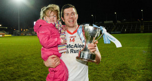 THAT'S MY DAD: Captain Seán Cavanagh  shows off the  Dr McKenna Cup with his four-year-old daughter Eva  after Tyrone's win over Cavan at the Athletic Grounds on Sunday. Picture: Sportsfile.