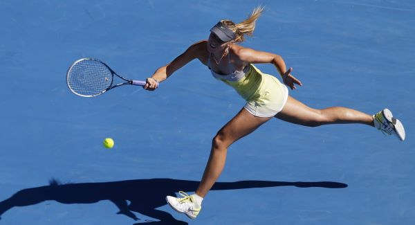 Russia's Maria Sharapova hits a forehand return to Belgium's Kirsten Flipkens during their fourth round match at the Australian Open.Picture: AP