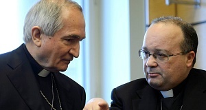 Vatican's UN Ambassador Monsignor Silvano Tomasi, left, speaks with Former Vatican Chief Prosecutor of Clerical Sexual Abuse Charles Scicluna, right