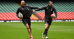 Ireland's Simon Zebo, left, and Rob Kearney joke around during yesterday's captain's  run in the Millennium Stadium.