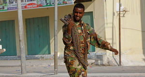 A Somali soldier walks on the street during fighting with militants today.