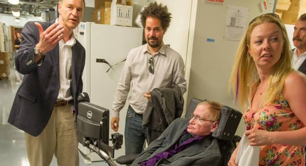 Clive Svendsen, PhD, left, director of the Cedars-Sinai Regenerative Medicine Institute, leads Stephen Hawking on a tour of the Regenerative Medicine Institute at Cedars-Sinai Medical Center in Los Angeles. Picture: AP