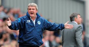 Wigan Athletic manager Steve Bruce complains about a decision on the touchline during the Barclays Premier League match at Ewood Park, Blackburn.