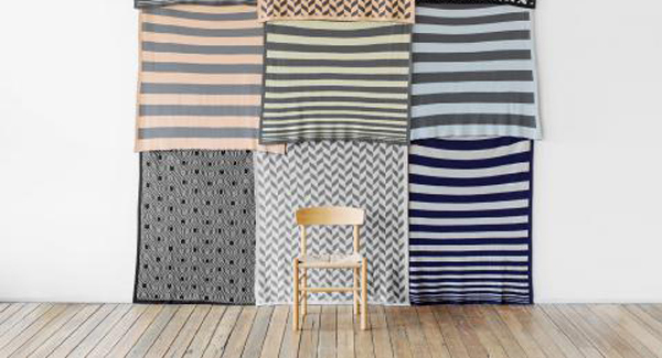 Be creative and hang striped rugs or throws to make wall art. This collage is by Australian company Cranmore Home but you can try it with your own selection of textiles.