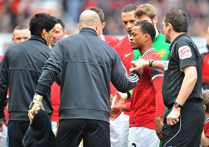 iverpool's Luis Suarez (left) refused to shake the hand of Manchester United's Patrice Evra ahead of the match at Old Trafford.