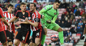Sunderland's John O'Shea and Fulham's Shaun Hutchinson battle for the ball during the FA Cup Fourth Round match at the Stadium of Light, Sunderland.