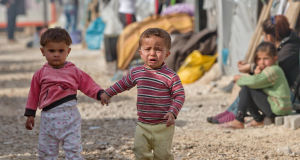 Syrian Kurdish refugee children from the Kobani area at a camp in Suruc, on the Turkey-Syria border. Picture: AP Photo/Vadim Ghirda
