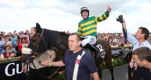 Thomas Edison with Tony McCoy up on their way into the winners' enclosure. Picture: INPHO