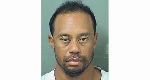 Dazed Tiger Woods struggles to walk in police arrest video