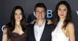 Tom Cruise with  Andrea Riseborough, left, and Olga Kurylenko during the Obliviion premiere in Brazil last week. Picture: AP