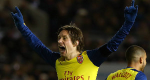 Arsenal's Tomas Rosicky celebrates after scoring his side's third goal. Pic: PA