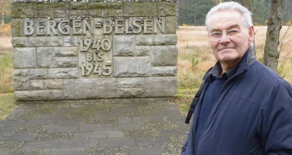 Tomi Reichental outsideBergen-Belsen in a scenefrom 'Close to Evil'