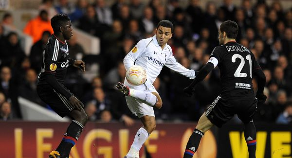 Tottenham Hotspur's Aaron Lennon battles for the ball with Lyon's Samuel Umtiti (left) and Maxime Gonalons (right).Picture: PA
