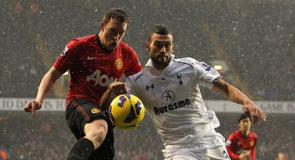 Manchester United's Phil Jones (left) and Tottenham Hotspur's Steven Caulker (right) battle for the ball.Picture: PA