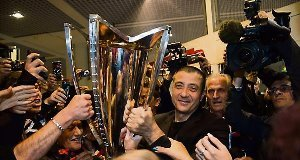 Toulon president Mourad Boudjellal shows off the European Champions Cup