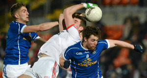 Padraig McNulty, Tyrone, in action against Killian Clarke and Damien O'Reilly, Cavan. McKenna Cup Final, Tyrone v Cavan, Athletic Grounds, Armagh. Picture credit: Oliver McVeigh / SPORTSFILE