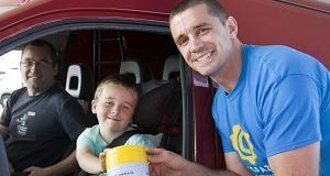 John Fitzgerald, 5, from New Inn with his dad - also John - making a donation.