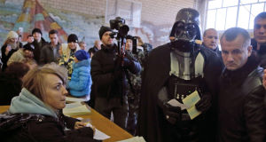 Darth Vader - aka Viktor Shevchenko, leader of the Ukrainian Internet Party - at a polling station in Kiev yesterday. Picture: AP