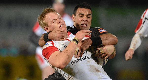 Luke Marshall, Ulster, is tackled by Kahn Fotuali'i, Ospreys. Picture: SPORTSFILE