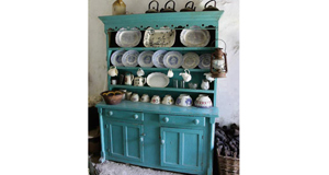 "An Irish dresser— ""in the paint"" — its original state. Set against the whitewashed wall of an Irish cottage, the look is a tourism staple but is also highly evocative for natives too."