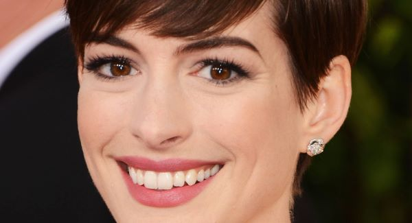 Anne Hathaway flashes her pearly white teeth