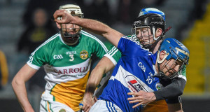 William Hyland of Laois in action against Offaly's Niall Wynne. Picture: Inpho