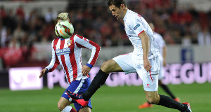 MAKING STRIDES: Sevilla'sGrzegorz Krychowiak goes past Atletico Madrid's AntoineGriezmann in yesterday's La Liga game  in Sevilla.Picture: Getty Images