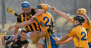 Linesman David Hughes keeps a close eye as Kilkenny's William Phelan clears the ball under pressure from Clare's Seadna Morey, David Reidy and Colm Galvin. Picture: Ray McManus