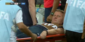 Gary Lewin on a stretcher after breaking his ankle while celebrating England's equaliser against Italy during the World Cup.