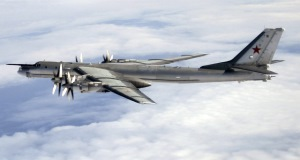 File photo of a Russian Tu-95 Bear H bomber being shadowed by an RAF Typhoon (Picture: RAF)