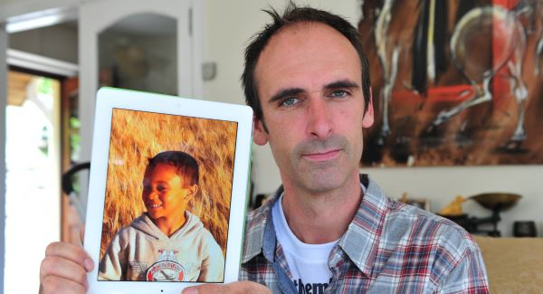 Richard Quarry holding a picture of his son Ethan, 7, in Kinsale, Co Cork, who was taken to Zambia in spite of his mother having lost custody. Picture: Dan Linehan